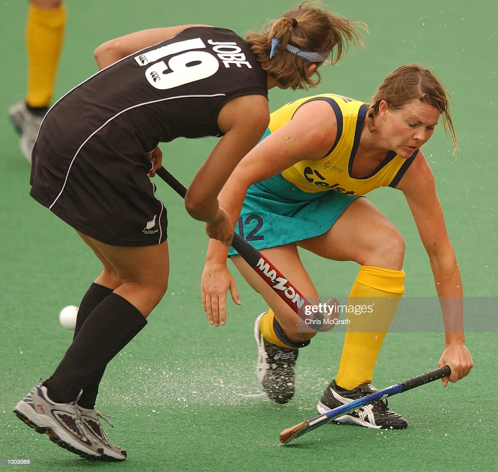 Brooke Morrison #12 of the Hockeyroos is tackled by Leisen Jobe #19 of the Black Sticks during the third hockey test match between the Australian Hockeyroos and the New Zealand Black Sticks held at the Sydney Hockey Centre, Homebush Bay, Sydney, Australia. DIGITAL IMAGE Mandatory Credit: Chris McGrath/ALLSPORT