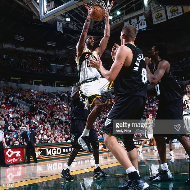 Calvin Booth of the Seattle SuperSonics goes up for a slam dunk against the Minnesota Timberwolves during a NBA Game at The Key Arena in Seattle...