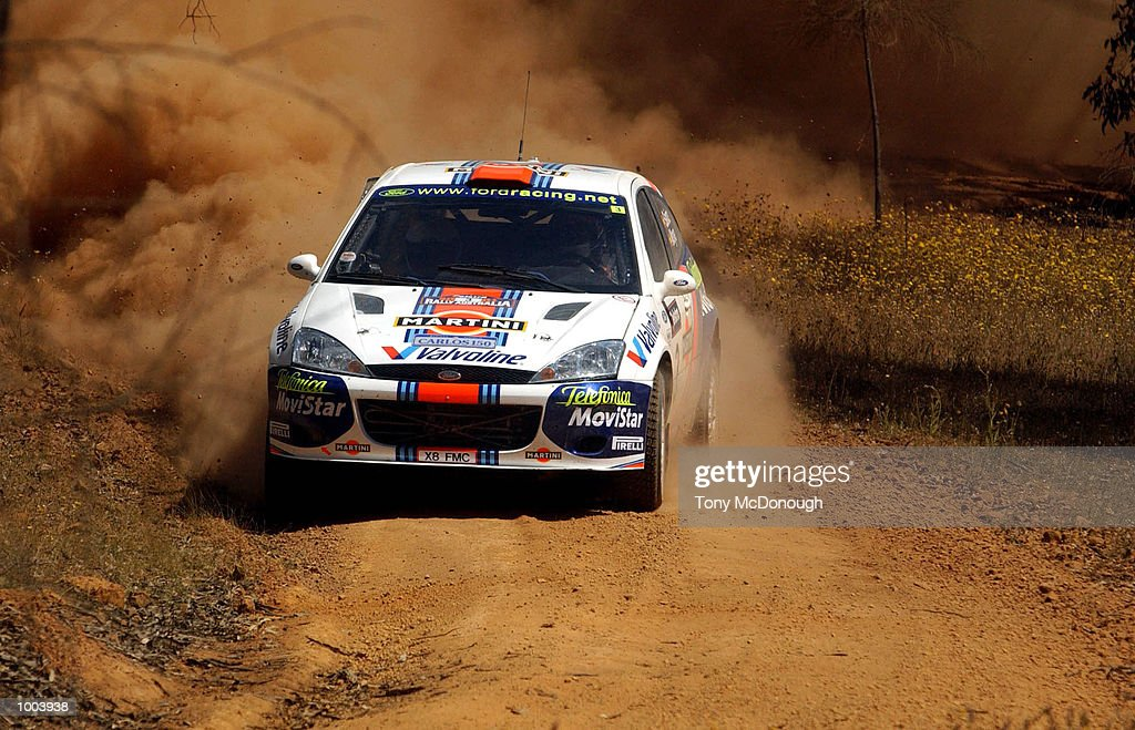 Carlos Sainz and co-driver, Luis Moya put their Ford Focus RS WRC 01 to the test on the outback bush tracks around Mundaring during the 19.98 km Special Stage Flynn's Short of Leg 1 of the Telstra Rally Australia at Perth, Australia. DIGITAL IMAGE Mandatory Credit: Tony McDonough/ALLSPORT
