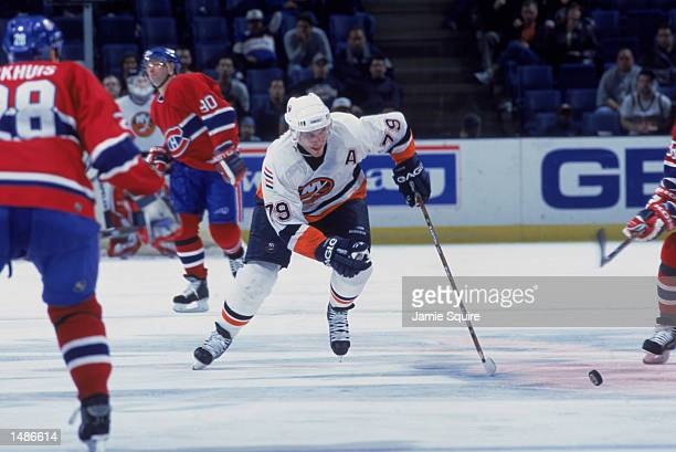 Center Alexei Yashin of the New York Islanders skates to the puck during the NHL game against the Montreal Canadiens at the Nassau Coliseum in...