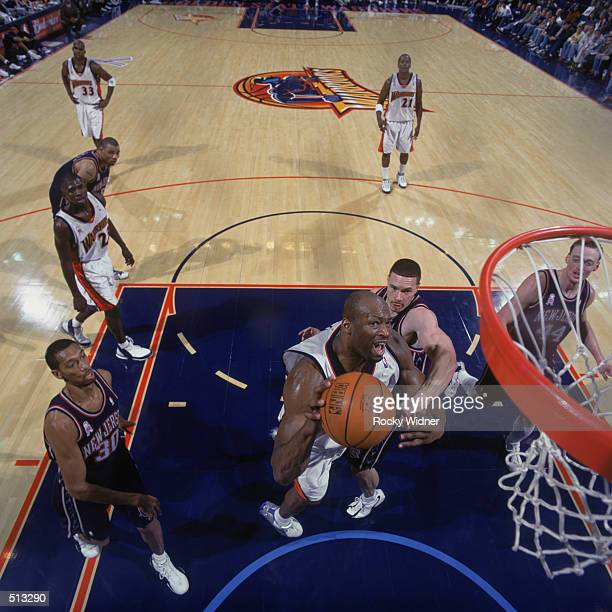 Center Erick Dampier of the Golden State Warriors goes to the basket during the NBA game against the New Jersey Nets at the Arena in Oakland in...