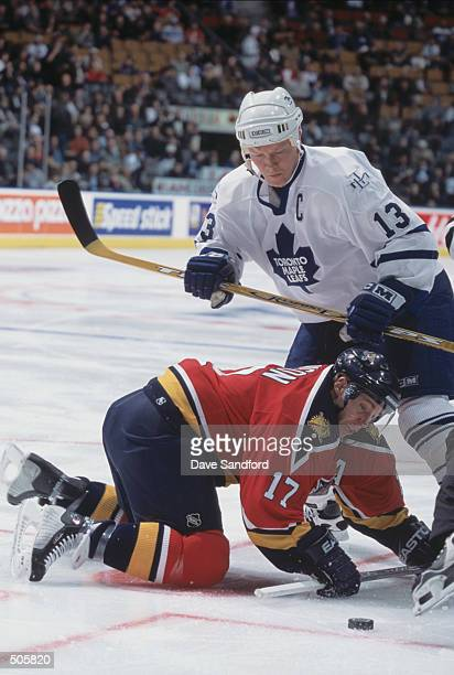 Center Mats Sundin of the Toronto Maple Leafs tries to get the puck off the faceoff from Ryan Johnson of the Florida Panthers during the NHL game at...