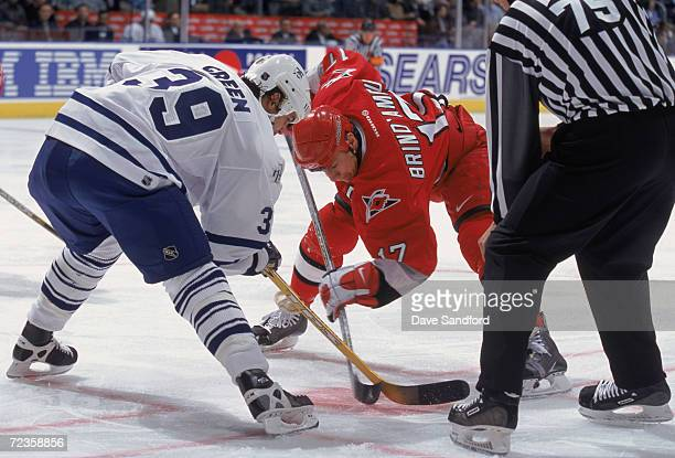 Center Rod Brind''Amour of the Carolina Huricanes and center Travis Green of the Toronto Maple Leafs face off during the NHL game at the Air Canada...
