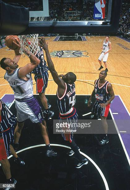 Center Vlade Divac of the Sacramento Kings shoots over guard Walt Williams of the Houston Rockets during the NBA game at Arco Arena in Sacramento...