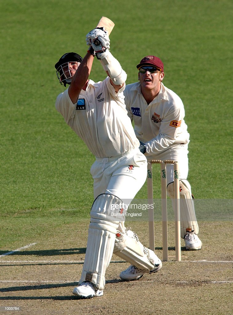 Chris Cairns of New Zealand hits six runs while Wade Seccombe of Queensland looks on during the New Zealand cricket teams tour match against Queensland played at the Gabba in Brisbane, Australia. DIGITAL IMAGE. Mandatory Credit: Darren England/ALLSPORT