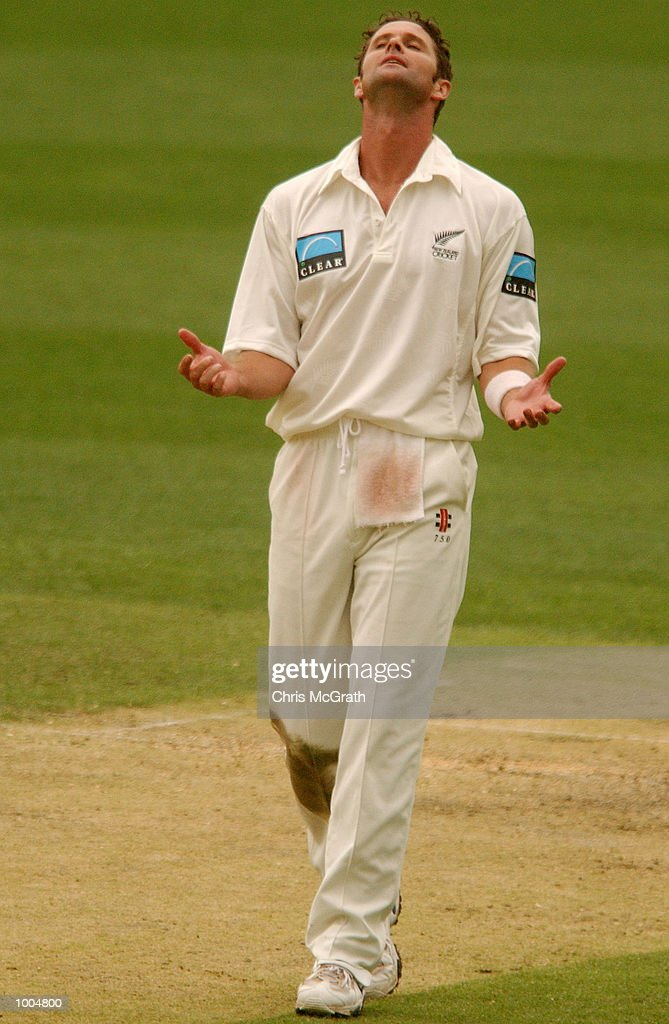 Chris Cairns of New Zealand looks to the heavens after he was hit for a boundary during day two of the first cricket test between Australia and New Zealand held at the Gabba, Brisbane, Australia, DIGITAL IMAGE Mandatory Credit: Chris McGrath/ALLSPORT