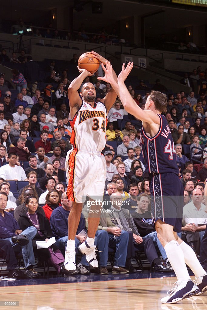 Chris Mills of the Golden State Warriors attempts a shot over Keith Van Horn of the New Jersey Nets during a game at The Arena in Oakland California...
