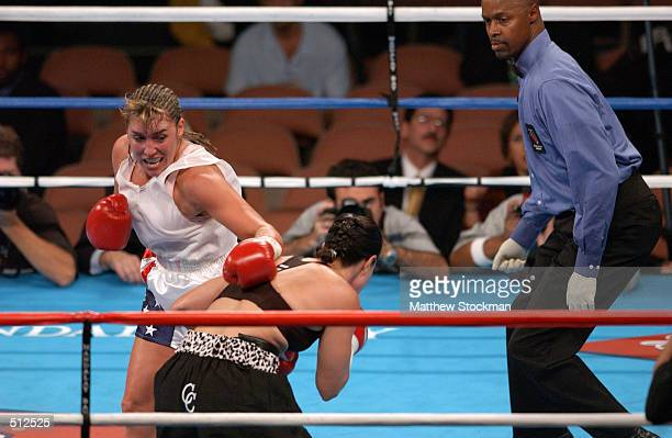 Christy Martin fails to make contact against Lisa Holewyne during the women's pound for pound championship fight at the Mandalay Bay Resort Casino in...