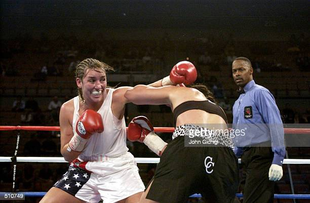 Christy Martin misses to land a jab against Lisa Holewyne during the women's pound for pound championship fight at the Mandalay Bay Resort Casino in...