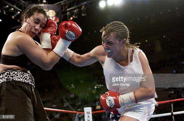 Christy Martin throws a right hook against Lisa Holewyne during the women's pound for pound championship fight at the Mandalay Bay Resort Casino in...