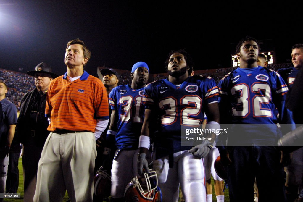 Coach <a gi-track='captionPersonalityLinkClicked' href=/galleries/search?phrase=Steve+Spurrier&family=editorial&specificpeople=228031 ng-click='$event.stopPropagation()'>Steve Spurrier</a> stands with Florida Gator players after beating Florida State 37-13 at Florida Field in Gainesville, Florida. DIGITAL IMAGE. Mandatory Credit: Matthew Stockman/Getty Images