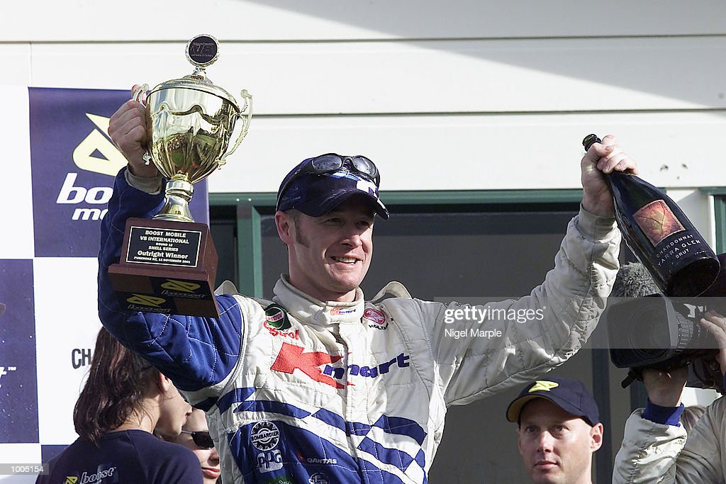 Commodore VX driver Greg Murphy #51 celebrates by holding up the round 12 winners trophy after winning race 3 during round 12 of the Shell championship series at Pukekohe Park Raceway, south of Auckland, New Zealand. Murphy won all 3 racesthis weekend to be the outright round 12 winner. Mandatory Credit: Nigel Marple/ALLSPORT