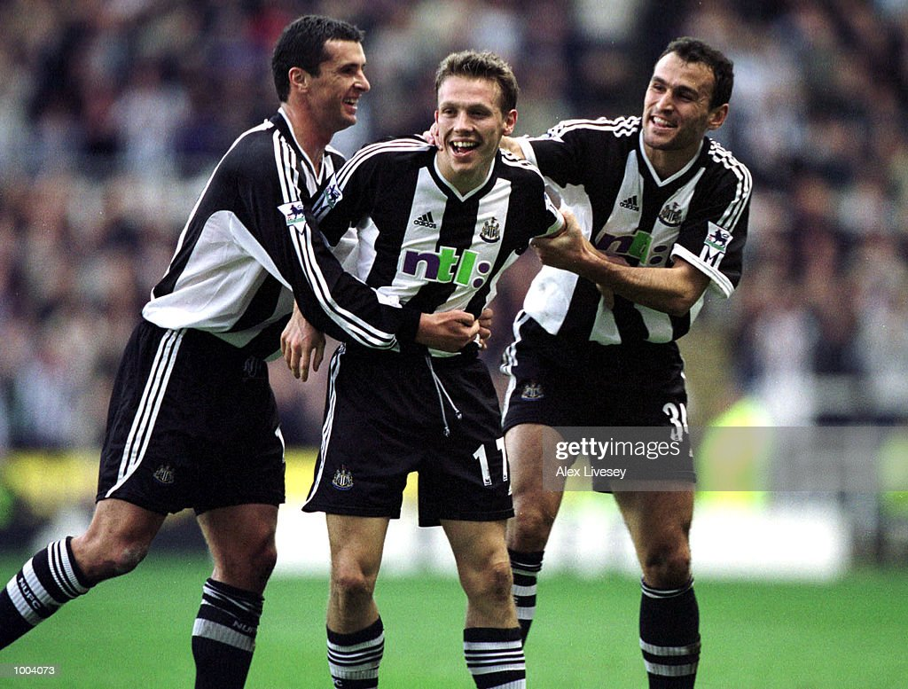 Craig Bellamy of Newcastle celebrates scoring with his team mates during the match between Newcastle United and Aston Villa in the FA Barclaycard Premiership at St James Park, Newcastle. Mandatory Credit: Alex Livesey/ALLSPORT