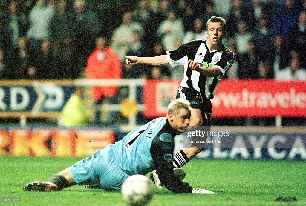 Craig Bellamy of Newcastle pulls a shot past Peter Schmeichel of Villa only to see his shot go wide of the post during the match between Newcastle United and Aston Villa in the FA Barclaycard Premiership at St James Park, Newcastle. Mandatory Credit: Laurence Griffiths/ALLSPORT