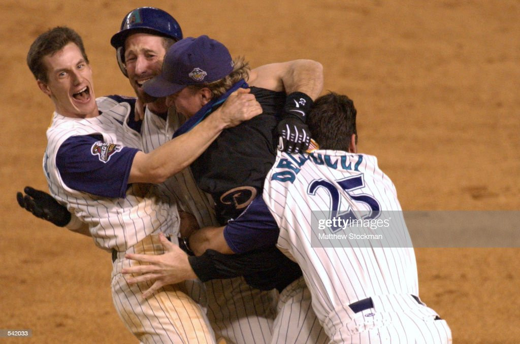 Craig Counsell Luis Gonzalez Curt Schilling and David Dellucci of the Arizona Diamondbacks celebrate defeating the New York Yankees to win game seven...