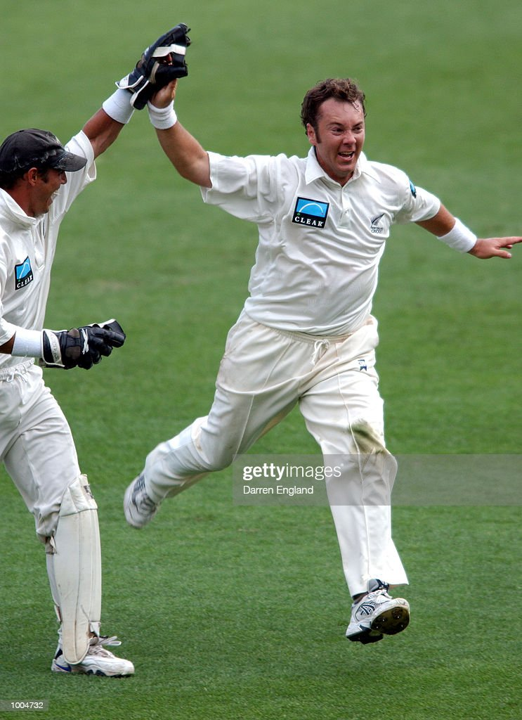 Craig McMillan of New Zealand celebrates the wicket of Justin Langer of Australia for 104 runs during day one of the first Cricket test between Australia and New Zealand played at the Gabba in Brisbane, Australia. DIGITAL IMAGE. Mandatory Credit: Darren England/ALLSPORT
