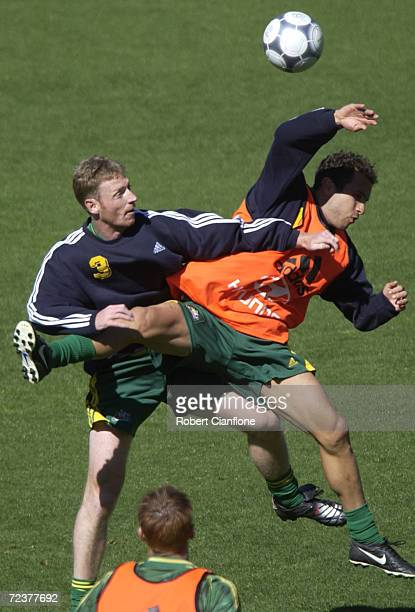 Craig Moore challenges Marco Bresciano during training as the Australians prepare to play the final leg of the World Cup qualifier against Uruguay...