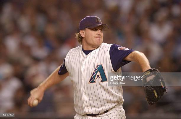 Curt Schilling of the Arizona Diamondbacks delivers in the top of the first inning against the New York Yankees during game seven of the Major League...