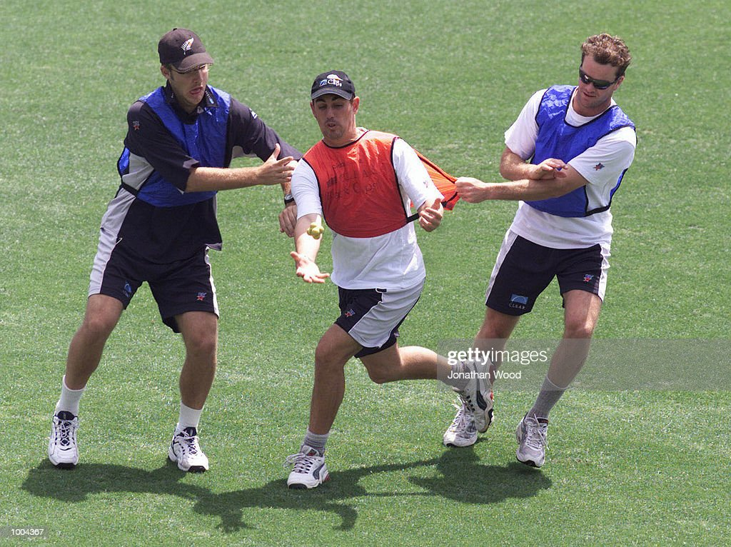 Daniel Vettori, Matthew Sinclair and Dion Nash (left to right) of New Zealand in action during a team training session held at the Gabba, Brisbane, Australia. DIGITAL IMAGE. Mandatory Credit: Jonathan Wood/ALLSPORT