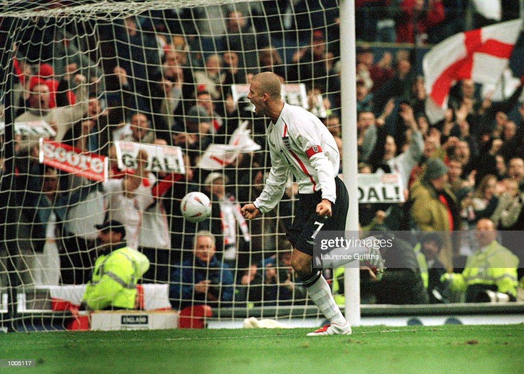 David Beckham of England celebrates after scoring the first goal during the England v Sweden International friendly at Old Trafford, Manchester. Mandatory Credit: Laurence Griffiths/ALLSPORT