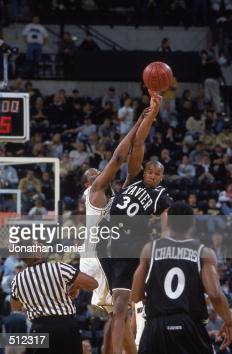 David West of the Xavier Musketeers leaps to tip the ball against Arthur Johnson of the Missouri Tigers during the game at the Conseco Fieldhouse in...