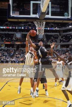 David West of the Xavier Musketeers makes a layup as he is blocked by Travon Bryant of the Missouri Tigers during the game at the Conseco Fieldhouse...