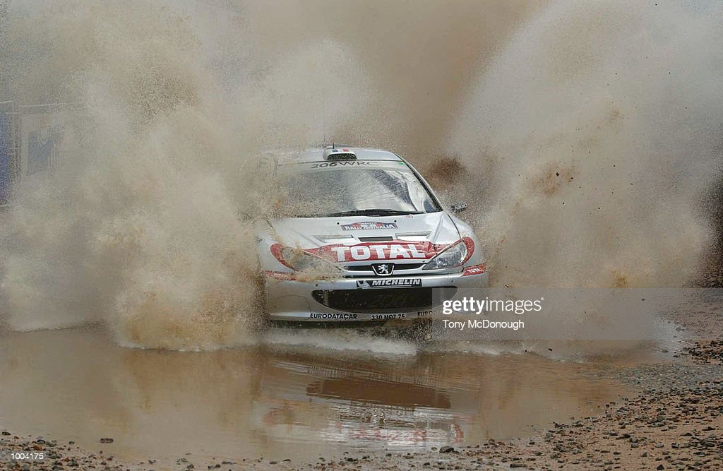 Didier Auriol and co-driver Deni Giraudet put their Peugeot 206 WRC through the water jump in the 4.19 km outback bush tracks around the Sotico Special Stage of the Telstra Rally Australia at Perth, Australia. DIGITAL IMAGE Mandatory Credit: Tony McDonough/ALLSPORT
