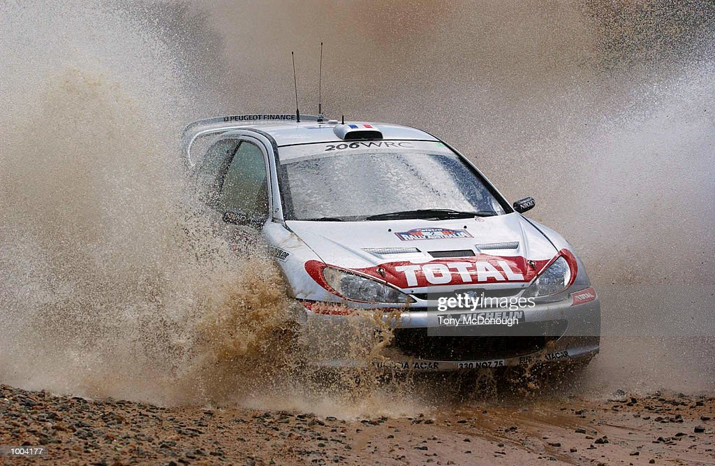 DidierAuriol and co-driver Deni Giraudet put their Peugeot 206 WRC through the water jump in the 4.19 km outback bush tracks around the Sotico Special Stage of the Telstra Rally Australia at Perth, Australia. DIGITAL IMAGE Mandatory Credit: Tony McDonough/ALLSPORT
