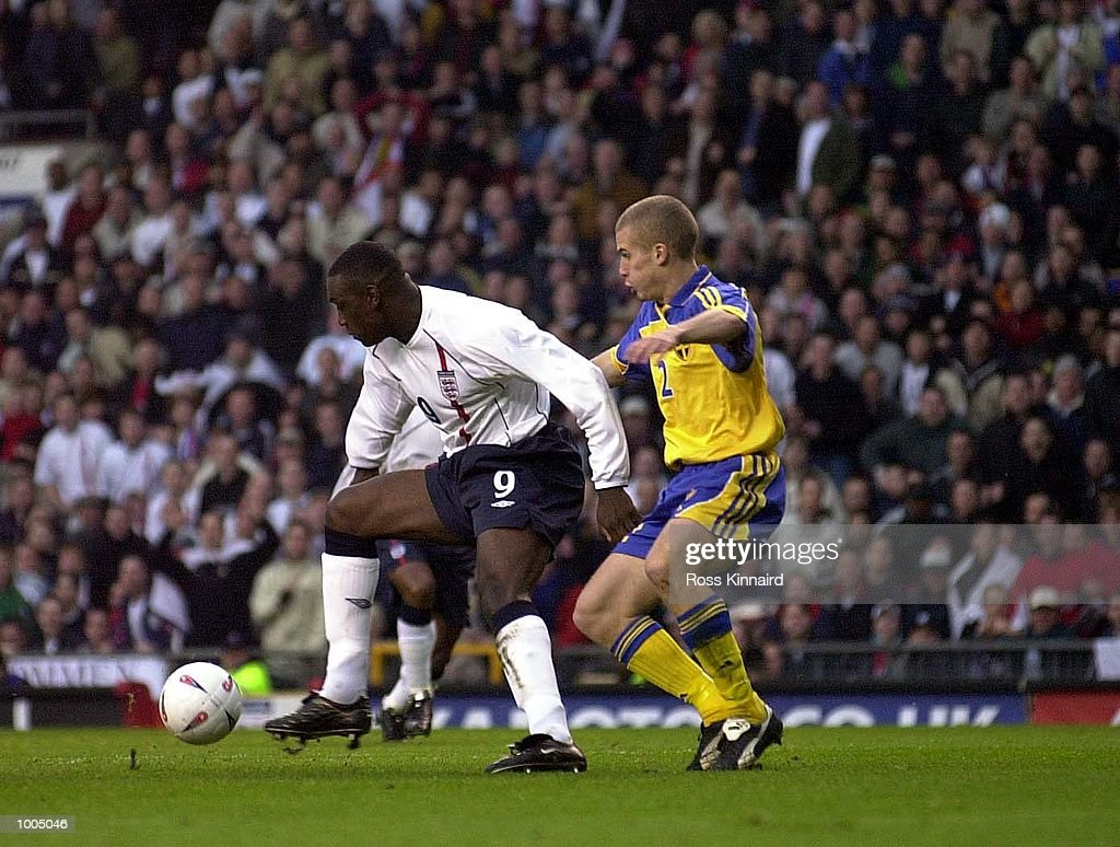 Emile Heskey of England battles with Christoffer Andersson of Sweden during the England v Sweden International friendly at Old Trafford, Manchester. DIGITAL IMAGE Mandatory Credit: Ross Kinnaird/ALLSPORT
