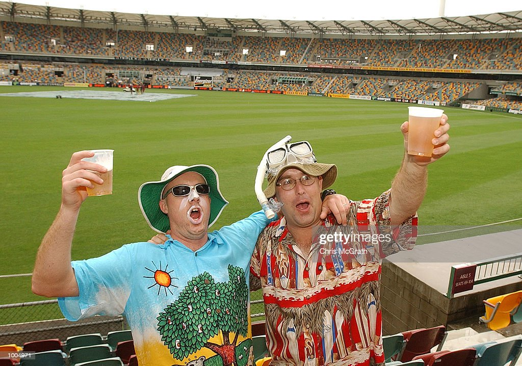 Fans wait for play to begin after rain delayed the start of play during day three of the first cricket test between Australia and New Zealand held at the Gabba, Brisbane, Australia, DIGITAL IMAGE Mandatory Credit: Chris McGrath/ALLSPORT
