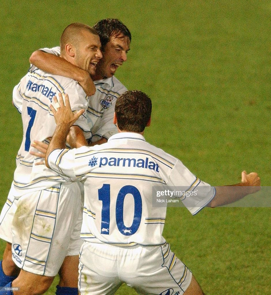 Fernando Rech #7 of the Strikers celebrates scoring the a goal with team mates during the NSL match between the Parramatta Power and the Brisbane Strikers held at Parramatta Stadium, Sytdney, Australia. Strikers 2 defeated the Power 1. DIGITAL IMAGE Mandatory Credit: Nick Laham/ALLSPORT