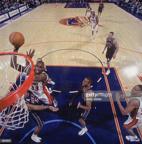 Forward Antawn Jamison of the Golden State Warriors shoots a layup during the NBA game against the New Jersey Nets at the Arena in Oakland in Oakland...