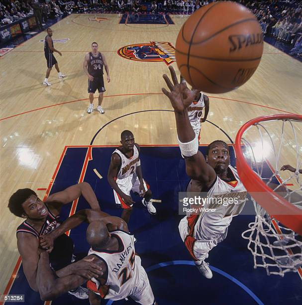 Forward Danny Fortson of the Golden State Warriors grabs a rebound during the NBA game against the New Jersey Nets at the Arena in Oakland in Oakland...