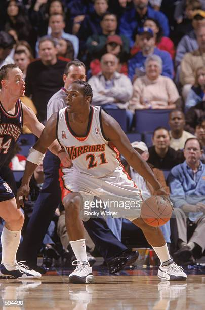 Forward Danny Fortson of the Golden State Warriors posts up forward Keith Van Horn of the New Jersey Nets during the NBA game at the Arena in Oakland...