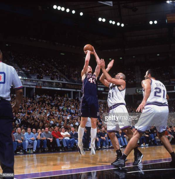 Forward Keith Van Horn of the New Jersey Nets shoots over forward Scot Pollard of the Sacramento Kings during the NBA game at Arco Arena in...