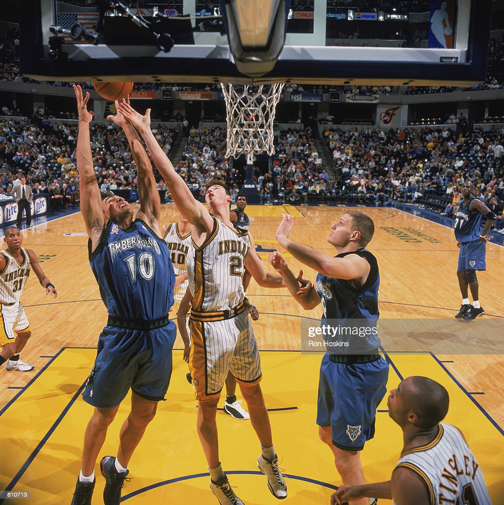 Wally Szczerbiak battles Primoz Brezec for a rebound