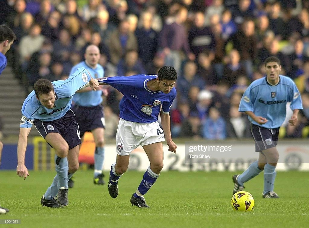 Gary Breen of Coventry holds back Tim Cahill of Millwall during the Millwall v Coventry City Nationwide League Division One match at the New Den, London. DIGITAL IMAGE. Mandatory Credit: Tom Shaw/ALLSPORT