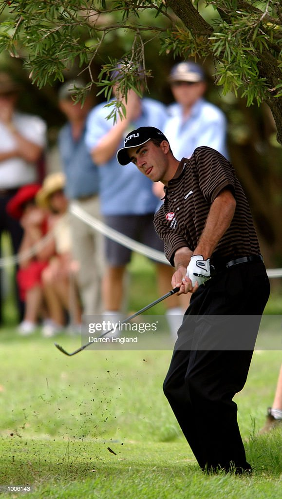 Geoff Ogilvy of Australia chips onto the 2nd green during the third round of the Australian PGA Championship being played at Royal Queensland Golf Club in Brisbane, Australia. He finished his round at 11 under par. DIGITAL IMAGE. Mandatory Credit: Darren England/ALLSPORT