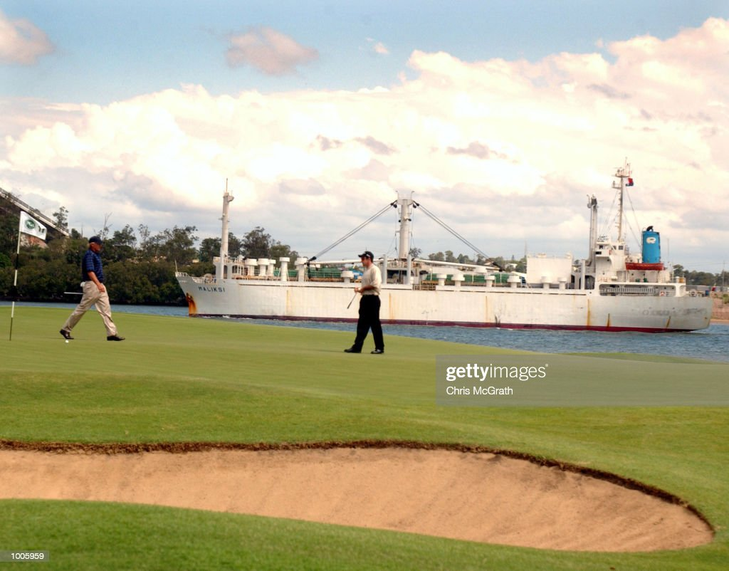 Greg Norman (left) and Paul Gow(right) on the 11th green as a ship cruises the Brisbane river during the second round of the Australian PGA Championships being played at Royal Queensland Golf Club, Brisbane, Australia. DIGITAL IMAGE Mandatory Credit: Chris McGrath/ALLSPORT