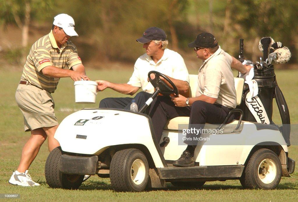 Greg Norman collects balls on the driving range during the Australian PGA Championship Pro AM held at Royal Queensland Golf Club, Brisbane, Australia. DIGITAL IMAGE Mandatory Credit: Chris McGrath/ALLSPORT