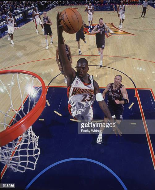 Guard Jason Richardson of the Golden State Warriors shoots a layup during the NBA game against the New Jersey Nets at the Arena in Oakland in Oakland...