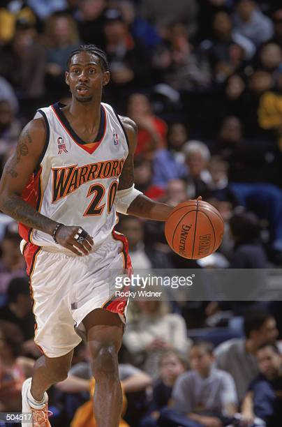 Guard Larry Hughes of the Golden State Warriors dribbles the ball during the NBA game against the New Jersey Nets at the Arena in Oakland in Oakland...