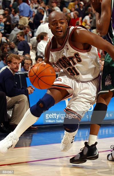 Guard Nick Van Exel of the Denver Nuggets drives against the Milwaukee Bucks on his way to scoring 31 first half points at the Pepsi Center in Denver...