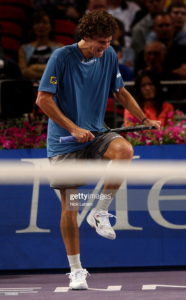 Gustavo Kuerten of Brazil attempts to break his racquet during his match against Juan Carlos Ferrero of Spain during the Tennis Masters Cup held at the Sydney Superdome, Sydney, Australia. DIGITAL IMAGE Mandatory Credit: Nick Laham/ALLSPORT
