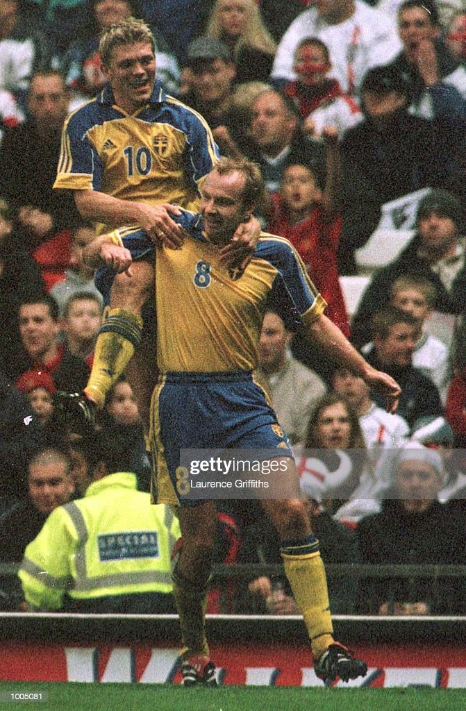 Hakan Mild of Sweden celebrates his goal with Marcus Allback during the England v Sweden International friendly at Old Trafford, Manchester. Mandatory Credit: Laurence Griffiths/ALLSPORT