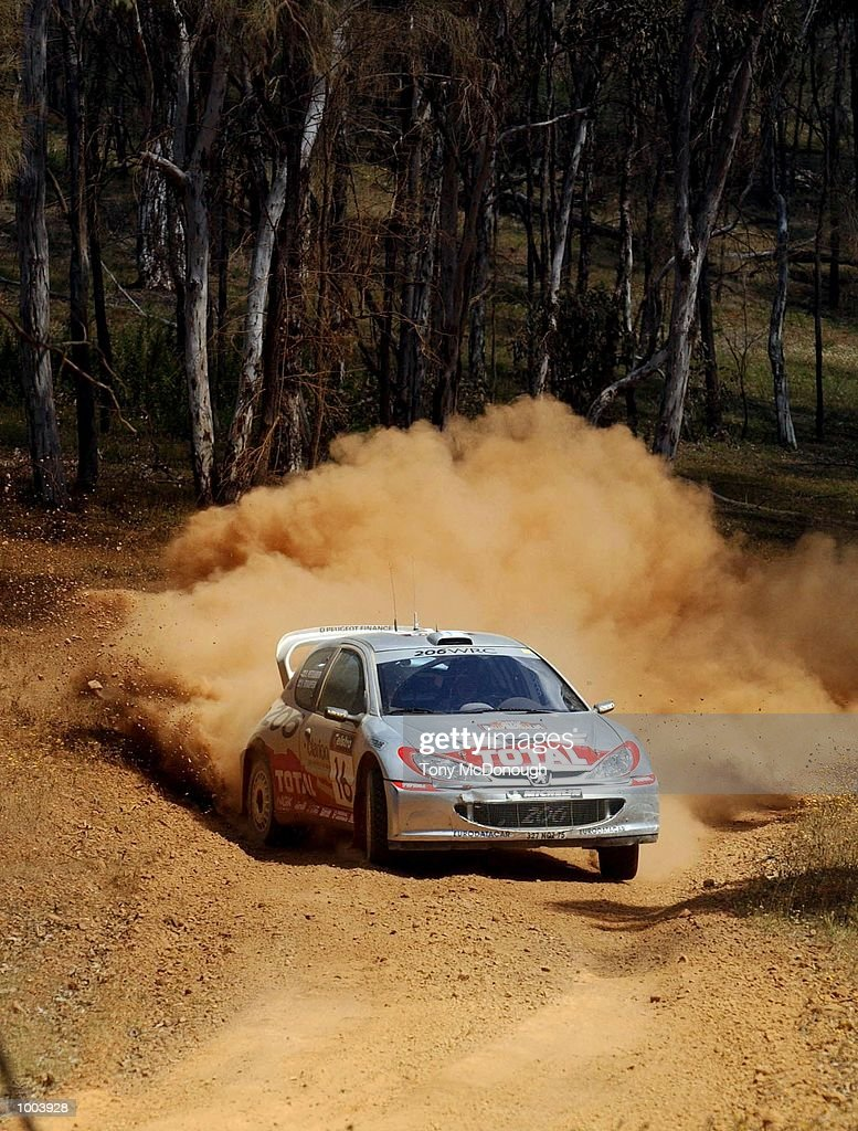 Harri Rovanpera and co-driver, Risto Pietilainen put their Peugeot 206 WRC to the test on the outback bush tracks around Mundaring during the 19.98 km Special Stage Flynn's Short of Leg 1 of the Telstra Rally Australia at Perth, Australia.DIGITAL IMAGE Mandatory Credit: Tony McDonough/ALLSPORT