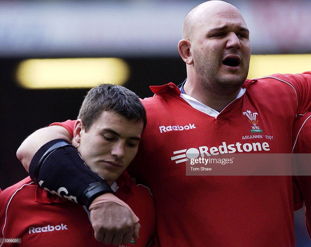 Iestyn Harris (left) of Wales is hugged by Craig Quinnell during the anthem before the Wales v Argentina International friendly match at the Millennium Stadium, Cardiff. DIGITAL IMAGE. Mandatory Credit: Tom Shaw/ALLSPORT