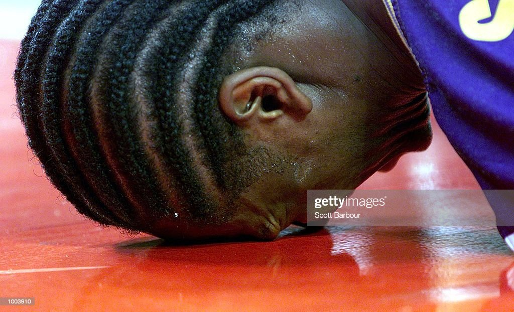 James Smith #34 of the Kings in agony after being injured during the Sydney Kings v Cairns Taipans match held at the Sydney Superdome in Sydney, Australia. DIGITAL IMAGE. Mandatory Credit: Scott Barbour/ALLSPORT