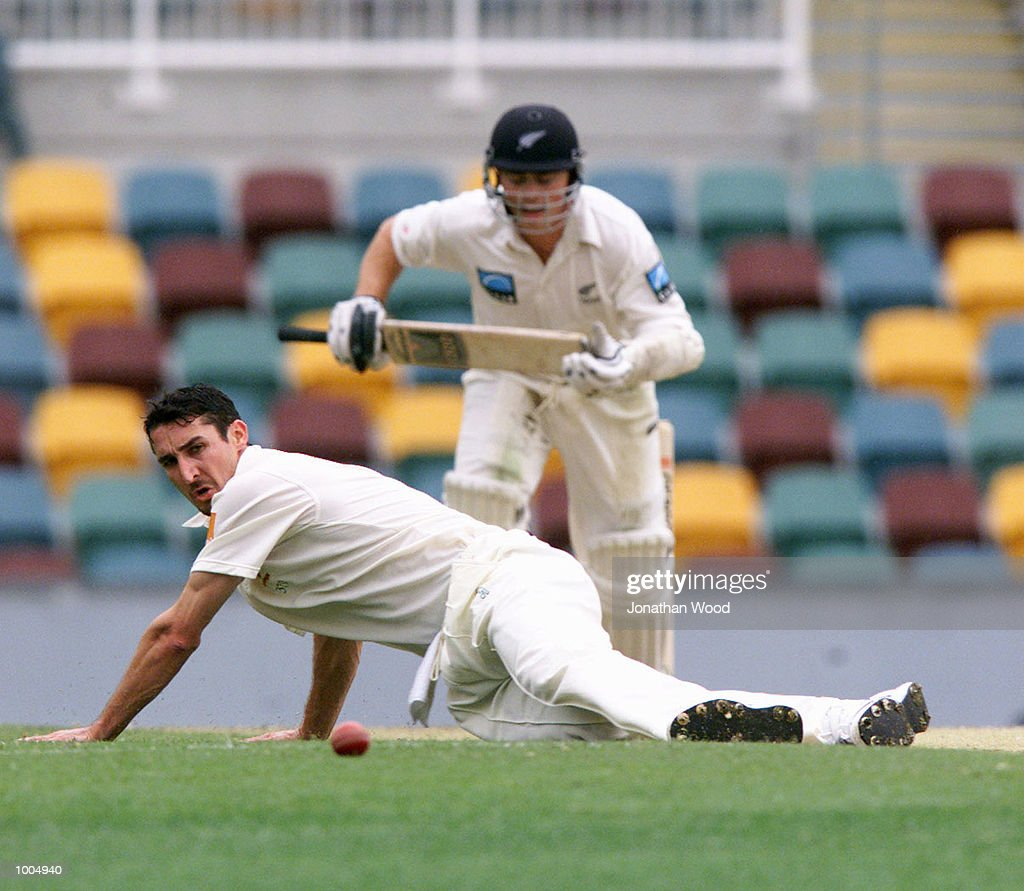 Jason Gillespie of Australia attempts to field his own bowling during the third day of play in the first Test between Australia and New Zealand being played at the Gabba, Brisbane, Australia. DIGITAL IMAGE. Mandatory Credit: Jonathan Wood/ALLSPORT
