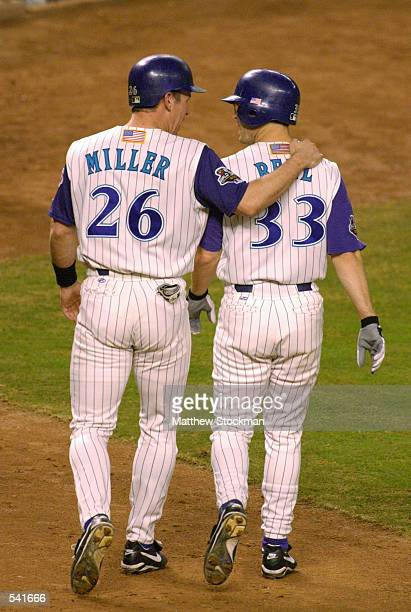 Jay Bell and Damian Miller of Arizona Diamondbacks walk back to the dugout after both scoring during game six of the World Series against the New...
